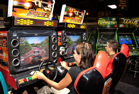 teens playing arcade video games